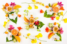 Colorful Pattern Of Whole And Sliced Exotic Fruits With Tropical Leaves And Flowers