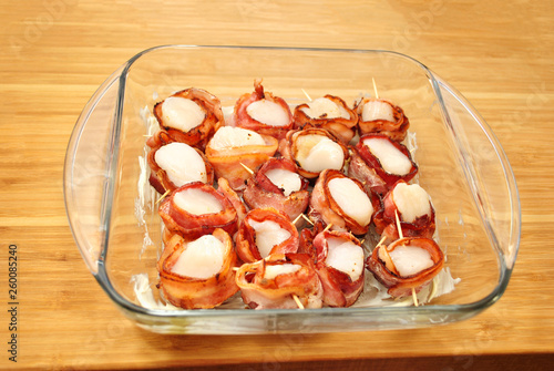 Fotografie, Obraz  Raw Scallops with Precooked Bacon in a Buttered Baking Dish