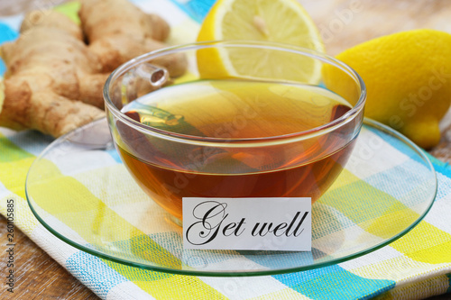 Valokuva  Get well card with cup of tea with fresh ginger and lemon