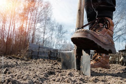 Canvastavla Boots and shovel closeup
