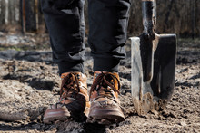 Boots And Shovel Closeup. The ...