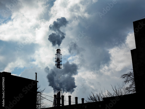 Keuken foto achterwand Nasa Industrial pipes smoke and release white smoke into the sky with clouds. Air pollution and harmful emissions from poor ecology of the environment and global warming.