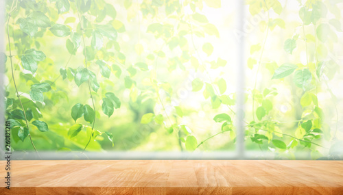 Stampa su Tela Wood table top on blur of window with garden flower background in morning