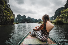 A Woman On A River Boat In Nin...
