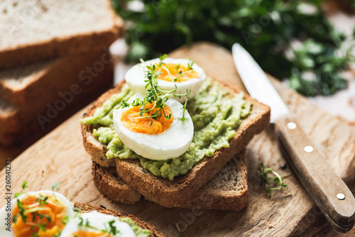 Tablou Canvas Healhy Breakfast Toast With Avocado, Boiled Egg On Wooden Cutting Board