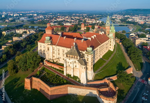 Fototapeta Historic royal Wawel castle and cathedral in Cracow, Poland.  Aerial view in sunrise light early in the morning obraz