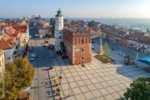 Sandomierz old city, Poland. Aerial view in sunrise light. Gothic city hall with clock tower and Renaissance attic and St Mary statue in the market Square (Rynek). One of the oldest towns in Poland.