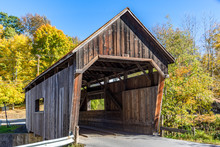 A Covered Bridge In Vermont In Autumn