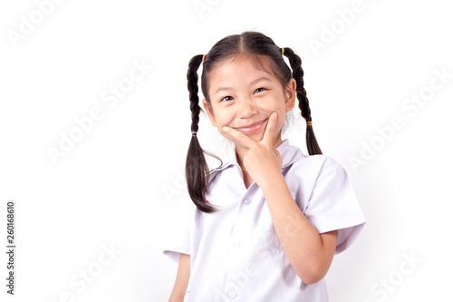 Foto  Happy Asian girl wearing school uniform on white background.