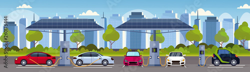 Fotografía electric cars charging on electrical charge station with solar panels renewable