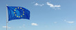 Leinwanddruck Bild - EU flag waving against blue sky with clouds. Copy space