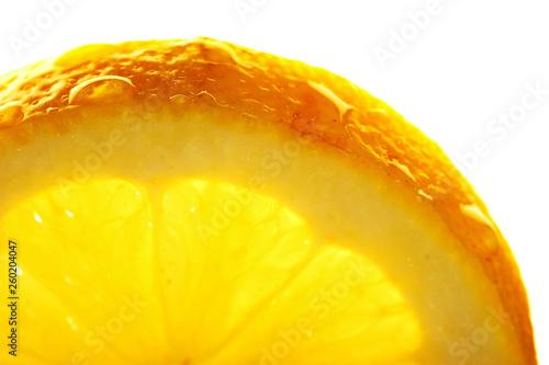 Spoed Foto op Canvas Plakjes fruit Lemon slice with a water droppings. Macro studio shot