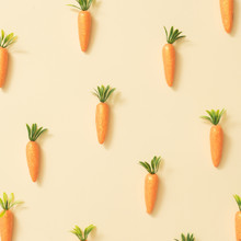 Carrots On Pastel Yellow Background. Easter Holiday Concept. Minimal Composition.