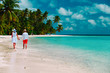 happy loving couple walk on beach, vacation concept