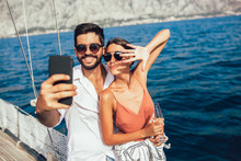Couple In Love On A Sail Boat In The Summer Make Selfie.