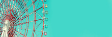 Colorful Cabins On A Ferris Wheel, Blue Sky Panoramic Background With Copy Space