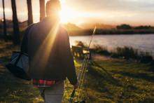 Man Going For Fishing Near A Lake