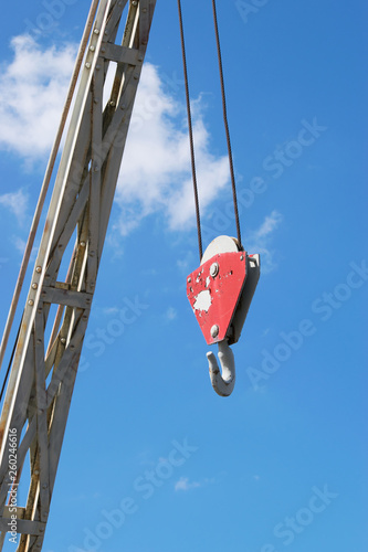 Fotografie, Obraz  Hanging crane hook against blue sky background.