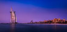 The Illuminated Burj Al Arab At Dawn With The Coastline Of Dubai