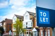 Leinwanddruck Bild - To Let sign on street of houses