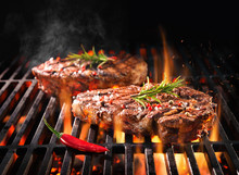 Beef Steaks Sizzling On The Gr...
