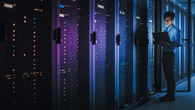In Dark Data Center: Male IT S...