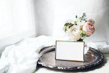 Spring, Summer Still Life. Blank Golden Photo Frame Mockup On Old Silver Tray Near Window. Vintage Feminine Styled Photo. Floral Composition Of Pink English Roses, Ranunculus And Eucalyptus.
