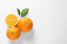 Juicy Oranges And Leaves On White Background, Top View
