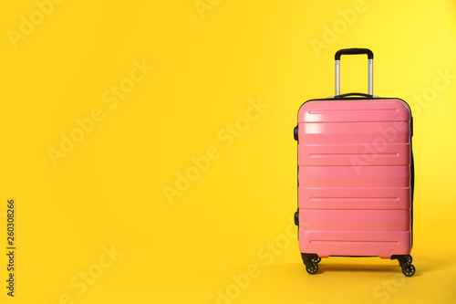 Valokuva Stylish suitcase on color background. Space for text