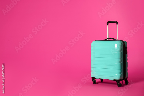 Photo Stylish suitcase on color background. Space for text