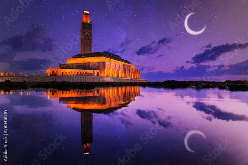 view of Hassan II mosque reflected on water at night - Casablanca - Morocco Fotobehang