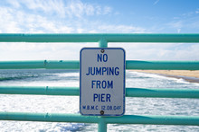 Sign Warns Visitors No Jumping From The Pier. Taken In Manhattan Beach, California