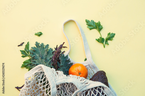 Fotomural  white eco-friendly textile string bag with fresh fruits, herbs and vegetables is
