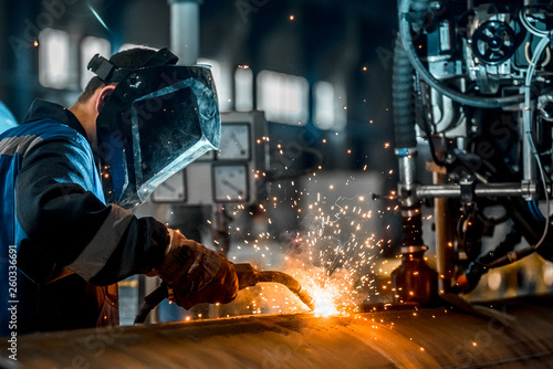 Fotografie, Obraz  man welds at the factory