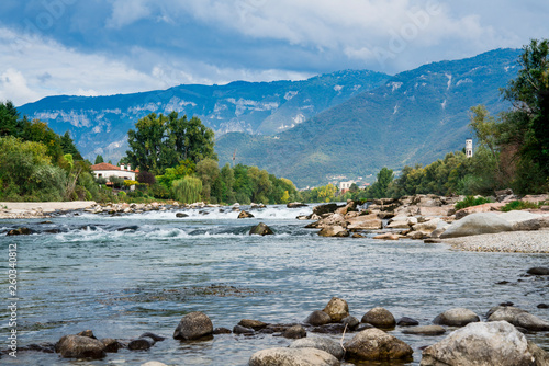 Canvas waterfall and rocks in river Brenta in Bassano del Grappa, Italy