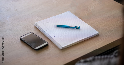 Valokuva  mobile phone on the table pencil letter book paper info meeting people business