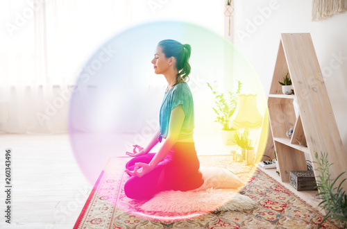 mindfulness, spirituality and healthy lifestyle concept - woman meditating in lo Fototapete