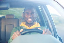Happy African American Man Driving Car