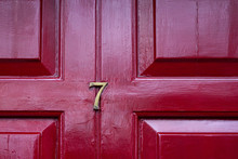 House Number Seven With The 7 In Brass On A Burgundy Red Front Door