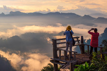 Young Asian Men Take Pictures In The Sunset View Point Of Doi Ang KhangCamping Site In Ban Ja-Bo, Pang Ma Pha, Mae Hong Son, Thailand