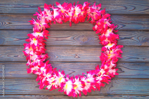 Hawaii wreath of flowers, on blue wooden background