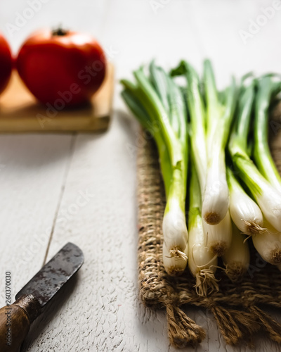 Fotografie, Obraz  Fresh Green Onions on White Wood
