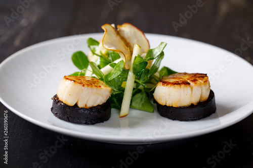Stampa su Tela Scallops with black pudding and apple and pea shoots salad