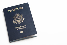 The Iconic Blue Cover Of An American Passport Deliberately And Artistically Set On A Plain White Background.