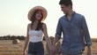 Pretty Woman Wearing Straw Hat Walking with her Beloved Man Outside. Couple of