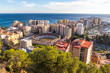 Skyline aerial view of Malaga city, Andalusia, Spain. Plaza de Toros de Malagueta bullring on the left