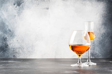 Set Of Hard Strong Alcoholic Drinks And Spirits In Glasses In Assortment: Vodka, Cognac, Brandy And Whiskey, Grappa. Gray Bar Counter Background, Selective Focus, Copy Space