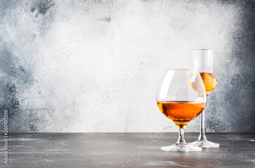 Poster de jardin Bar Set of hard strong alcoholic drinks and spirits in glasses in assortment: vodka, cognac, brandy and whiskey, grappa. Gray bar counter background, selective focus, copy space