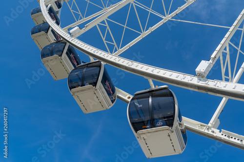 Fotografie, Obraz  Ferris Wheel in the National Harbor near Washington DC with blue sky