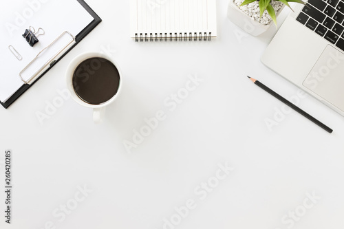Fototapeta Flay lay, Top view office table desk with smartphone, keyboard, coffee, pencil, leaves with copy space background. obraz na płótnie
